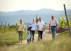 langenwalter winemakers family stroll through lush vineyards near winery