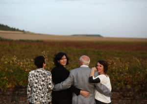 ochoa winery four visitors stroll through lush vineyards near winery