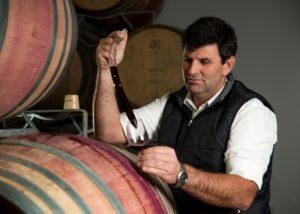 ormonde wine estate owner inspecting wine from wooden barrel