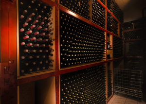 papantonis winery many bottles of beautiful wine on wooden shelves