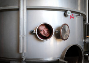 papantonis winery happy winemaker inside steel tank for wine production