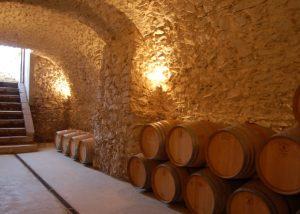 Illuminated stone wine cellar in the Capolino Perlingieri winery.
