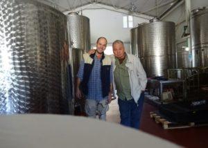 petralona winery two winemakers in laboratory near steel tanks
