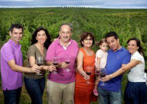 quinta da ribeirinha winemakers family in the vineyard near winery in portugal
