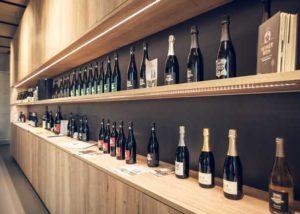 reif & nett many bottles of beautiful wines on wooden shelves
