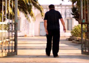 Romaldo Greco owner walking through winery gates in Italy