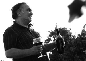 Romaldo Greco owner tasting wines in Italy