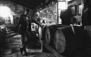 stancija collis black and white photo of wine tasting session