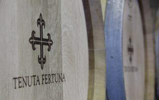 barrels with logo in Tenuta Fertuna winery located in Italy