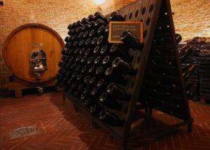 Tenuta Magda Pedrini winery cellar full of bottles in Italy