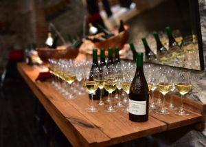 tsinandali estate bottles and glasses with stunning white wine ready for tasting