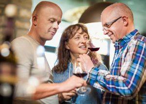 Three people tasting red wine at Weingut Ernst Bretz