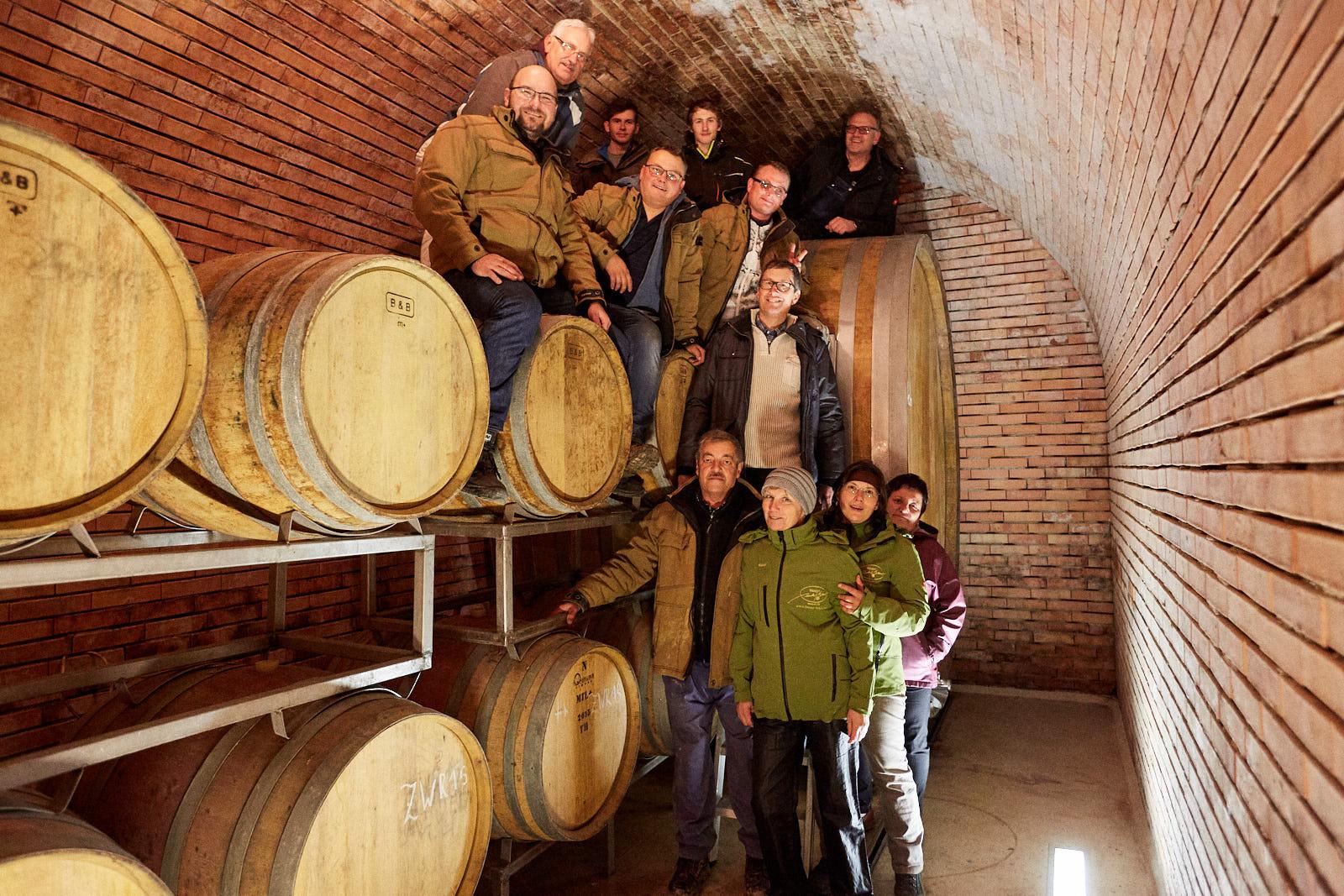weingut norbert bauer winemakers near wooden barrels inside wine cellar