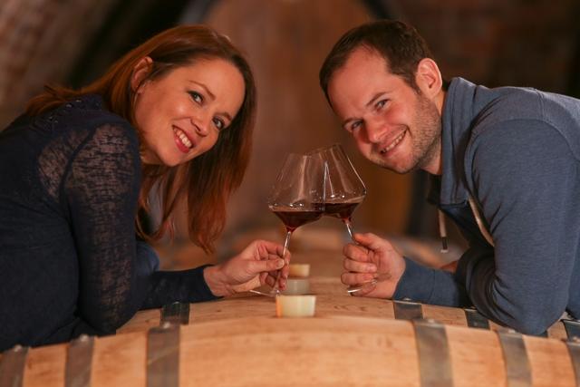 weingut tom dockner owners tasting amazing red wines in the cellar