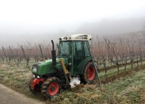 weingut zimmerlin green tractor on the vineyard near winery in lovely germany