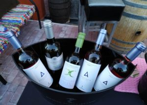 Bottles of wine by estate manolesakis winery in a bucket