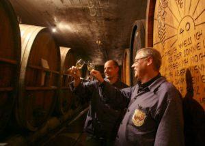 Two men tasting wines in the cellar of Bickensohler Weinvogtei eG winery.