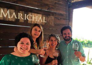 A man and three women enjoying their wine at Bodega marichal winery