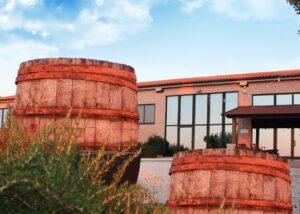 Brick colored building of Bruscia Vini winery with big glass windows