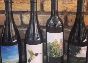 Four bottles of wine by Burning tree cellars
