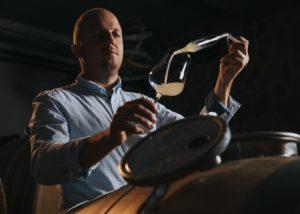 A man doing wine tasting at Frešer winery