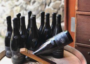 Bottle of wine by Hamacher wines on a wine barrel