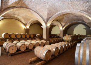 Wine barrels inside the cellar room at Menegotti winery
