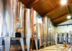 Large fermentation tanks at Menegotti winery