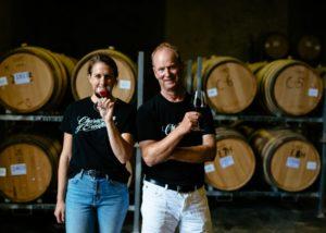Winemakers posing inside the cellar of Palliser Estate Wines winery