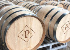 Barrels arranged in rows at Peltier winery