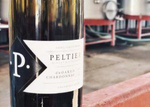 A close shot of a bottle of wine by Peltier winery