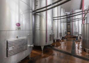 Large fermentation tanks at Shumi Winery