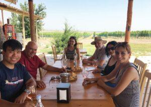 Group of people tasting wine in the outdoor area at Van ardi winery