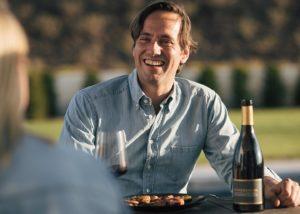Owner of Weingut dreissigacker winery tasting wine