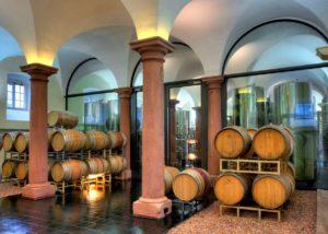 Wine barrels stacked together in the cellar of Weingut Fürst Löwenstein winery.