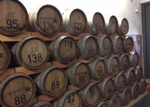 Wooden barrels stacked onto eack other in the cellar of Weingut Fürst Löwenstein winery