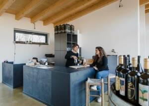 two women tasting wine at azienda agricola il poggio