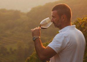 A Man Tasting Wine At Azienda Vinicola Emilio Franzoni Winery