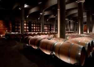 barrels inside Bodegas Manzanos winery cellar in Spain