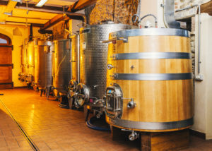 storage of wines in huge wooden barrels at biovio