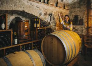 wine maker testing wines in the cellar at biovio