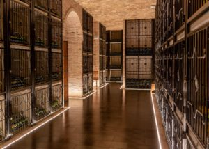 Bottled wines stored in metal cells at Bodegas Francisco Gomez tasting room.