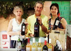 Bodegas Jer winemakers holding bottles of wine in Spain