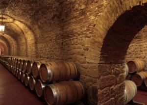 Barrels of wines stored in cellar at Bodegas Riojanas.