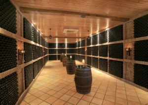 a lot of wine bottles inside Bodegas Alvia winery cellar