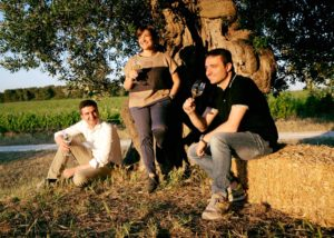 Organic wine tasting against the backdrop of the vineyard Cantine Amastuola.
