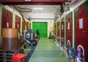 cà bruciata huge tanks for wine production inside laboratory