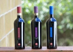 three bottles of Carus Vini winery
