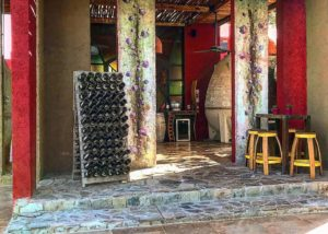 casa vigil wine bottles on shelves in the amazing courtyard