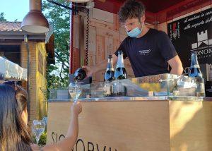 A Bartender Serving Wine At Castello Bonomi Winery
